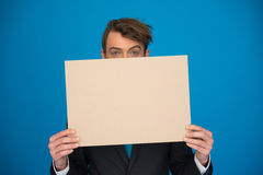 Businessman holding blank poster Royalty Free Stock Images