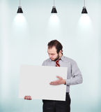 Businessman holding blank poster Royalty Free Stock Photos