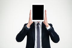 Businessman holding blank screen tablet in front of his head Stock Photos