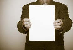 Businessman holding blank sheet of paper. Business concept. Stock Photography