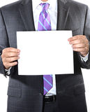 Businessman holding a blank sheet of paper Stock Image