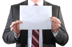 Businessman holding a blank sheet of paper Stock Images