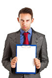 Businessman holding a blank sign Royalty Free Stock Photography
