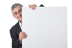 Businessman holding a blank sign Stock Image
