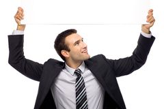 Businessman holding blank sign above his head Stock Photos