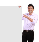 Businessman holding a blank sign in front of him Stock Photo