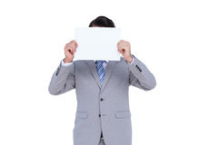 Businessman holding blank sign in front of his head Royalty Free Stock Photo