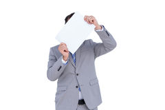 Businessman holding blank sign in front of his head Royalty Free Stock Photography