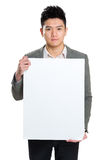 Businessman holding blank sign Royalty Free Stock Photo