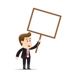 Businessman holding blank sign Stock Image