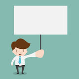 Businessman holding blank sign. Stock Image