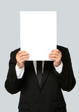 Businessman Holding Blank Signboard. An unrecognizable businessman holding up a blank signboard Stock Images