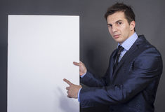 Businessman holding blank table for text Royalty Free Stock Photos