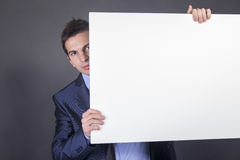 Businessman holding blank table for text Stock Photography