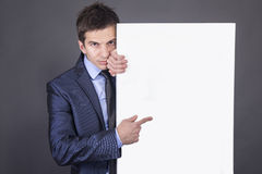 Businessman holding blank table for text Stock Photo