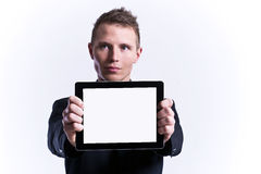 Businessman holding blank tablet Royalty Free Stock Photos