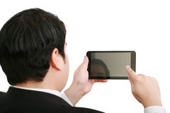 Businessman holding a blank touchpad Royalty Free Stock Photo