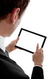 Businessman holding a blank touchpad pc. One finger touches the screen, isolated on white you can add whatever you want in the screen, your Homepage, a stock photography