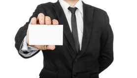Businessman holding blank visit card Stock Images