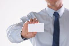 Businessman holding blank visit card isolated on white background Royalty Free Stock Photo