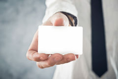 Businessman holding blank visiting card with rounded corners Royalty Free Stock Photos