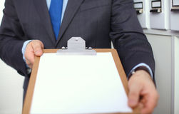 Businessman holding a blank white board Royalty Free Stock Image