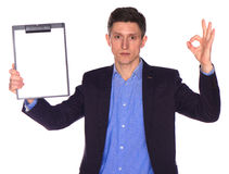 Businessman holding a blank white board Royalty Free Stock Photography