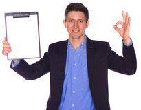 Businessman holding a blank white board Stock Photos
