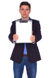 Businessman holding a blank white board Royalty Free Stock Photo