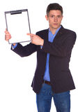 Businessman holding a blank white board Royalty Free Stock Images