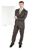 Businessman holding blank white board Stock Photography