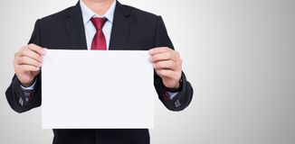 Businessman holding blank white paper Royalty Free Stock Photography