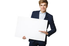 Businessman holding blank whiteboard Stock Image