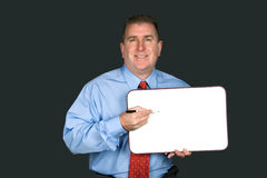 Businessman holding blank whiteboard Stock Photos