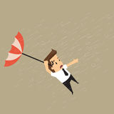 Businessman holding a blow umbrella in the middle of a rainstorm Royalty Free Stock Images