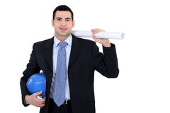 Businessman holding  a blueprint Royalty Free Stock Photos