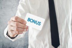 Businessman holding Bonus card. Stock Photography