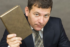 Businessman holding a book Stock Photography