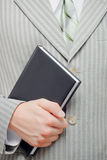 Businessman holding book Stock Image