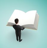 Businessman holding book Stock Photos