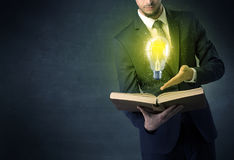 Businessman holding a book. Royalty Free Stock Image