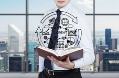 Businessman holding book Royalty Free Stock Photos
