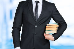 Businessman holding a book closeup Royalty Free Stock Photo