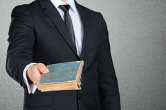 Businessman holding a book closeup Royalty Free Stock Images