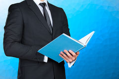 Businessman holding a book closeup Royalty Free Stock Image