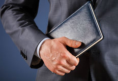 Businessman holding a book Royalty Free Stock Photo
