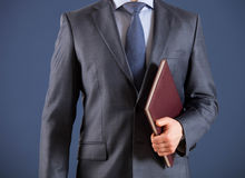 Businessman holding a book Royalty Free Stock Images
