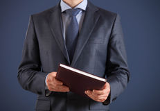 Businessman holding a book Stock Images