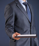 Businessman holding a book Royalty Free Stock Photos