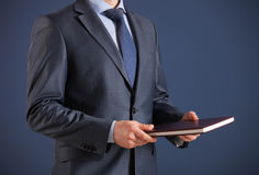 Businessman holding a book Stock Image